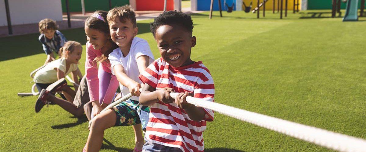 Preschoolers playing tug of war